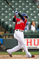 Round Rock Express outfielder Engel Beltre #7 follows through on his swing against the Omaha Storm Chasers in the Pacific Coast League baseball game on April 7, 2013 at the Dell Diamond in Round Rock, Texas. Omaha beat Round Rock 5-2, handing the Express their first loss of the season. (Andrew Woolley/Four Seam Images).