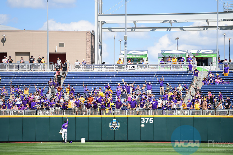 OMAHA, NE - JUNE 26: Zack Hess (38) of Louisiana State University throws balls to fans before his team takes on the University of Florida during the Division I Men's Baseball Championship held at TD Ameritrade Park on June 26, 2017 in Omaha, Nebraska. The University of Florida defeated Louisiana State University 4-3 in game one of the best of three series. (Photo by Justin Tafoya/NCAA Photos via Getty Images)
