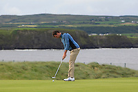 Jake Whelan (Newlands) on the 3rd green during Matchplay Round 1 of the South of Ireland Amateur Open Championship at LaHinch Golf Club on Friday 22nd July 2016.<br /> Picture:  Golffile | Thos Caffrey<br /> <br /> All photos usage must carry mandatory copyright credit   (© Golffile | Thos Caffrey)