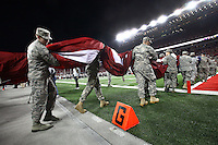 Soldiers take a giant American flag on the field for the National Anthem before an NCAA football game between the Ohio State Buckeyes and the Minnesota Golden Gophers at Ohio Stadium on Saturday, November 7, 2015. (Columbus Dispatch photo by Fred Squillante)