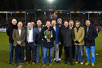 Members of the 1998 Heineken Cup winning Bath Rugby team pose for a photo with the trophy at half-time. European Rugby Champions Cup match, between Bath Rugby and the Scarlets on January 12, 2018 at the Recreation Ground in Bath, England. Photo by: Patrick Khachfe / Onside Images