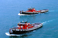 Two Tugboats, the Pennsylvania and the Wyoming cross the Detroit River at Zugg Island to help the M V George Stinson come to dock. 05-1010. Detroit Michigan USA Detroit River...