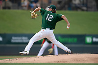 Starting pitcher Chase Shugart (12) of the Greenville Drive delivers a pitch in a game against the Rome Braves on Sunday, June 30, 2019, at Fluor Field at the West End in Greenville, South Carolina. Rome won, 6-3. (Tom Priddy/Four Seam Images)