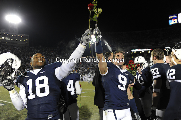 22 November 2008:  Penn State's Navorro Bowman (18) and Mark Rubin (9) celebrate after the game with their roses as Penn State clinched a Rose Bowl berth.  The Penn State Nittany Lions defeated the Michigan State Spartans 49-18 to win the Land Grant Trophy and 2008 Big Ten Conference Championship at Beaver Stadium in State College, PA..