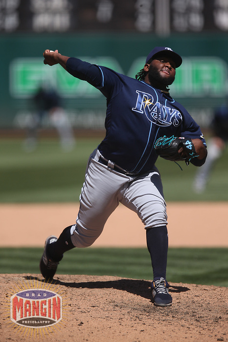 OAKLAND, CA - JUNE 22:  Diego Castillo #63 of the Tampa Bay Rays pitches against the Oakland Athletics during the game at the Oakland Coliseum on Saturday, June 22, 2019 in Oakland, California. (Photo by Brad Mangin)