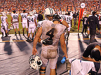 Brigham Young quarterback Taysom Hill (4) receives a hug Brigham Young tight end Richard Wilson as the clock runs out during the game against Virginia in Charlottesville, Va. Virginia defeated Brigham Young 19-16. Photo/Andrew Shurtleff
