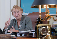 PQ leader Pauline Marois gestures as she talk to a reporter during a site down interview at her office in the National Assembly in Quebec City Tuesday April 12, 2011.