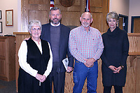 MEGAN DAVIS/MCDONALD COUNTY PRESS Family, friends and co-workers gathered on Thursday, Dec. 27 to bid farewell to long-time elected officials and courthouse comrades. From L to R: Treasurer Joye Helm, Circuit Judge Timothy Perigo, Presiding Commissioner Keith Lindquist and Circuit Court Clerk Jennifer Mikeska. Sheila Foreman will take on the seat of Treasurer, Bill Lant will take on the seat of Presiding Commissioner, Gregory Stremel will take on the seat of Circuit Judge and Tanya Lewis will take on the seat of Circuit Court Clerk in the coming year.