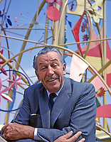"Walt Disney in front of the Tower of the Four Winds, ""It's a Small World"" Exhibit, 1964 World's Fair, Flushing Meadows, New York. Photo by John G. Zimmerman."