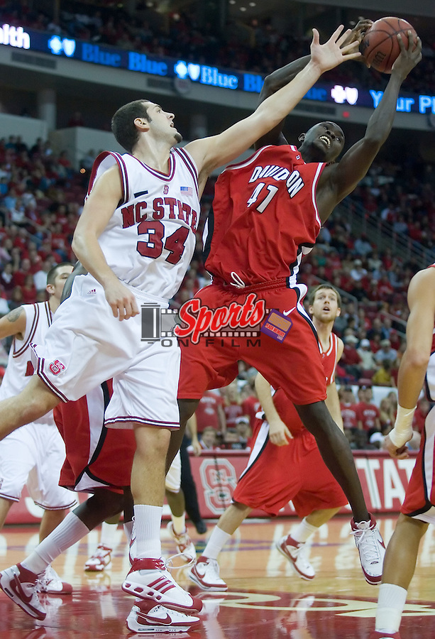 Davidson's Andrew Lovedale (41) grabs a rebound away from North Carolina State's Ben McCauley (34) during second half action at the RBC Center in Raleigh, NC, Friday, December 21, 2007.  The Wolfpack defeated the Wildcats 66-65.