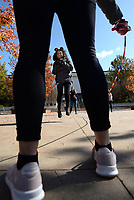 NWA Democrat-Gazette/ANDY SHUPE<br /> Shyann Graham (center), a University of Arkansas staff member from Jamaica, jumps rope Thursday, Oct. 31, 2019, as Amber McCarthy (foreground), a student from Bentonville, and Alexis Garner, a student from White Hall, swing the rope as they take part in the Fall Field Day sponsored by Exercise is Medicine on the Arkansas Union Mall on the university campus in Fayetteville. The event is organized to encourage exercise through play among members of the campus community.