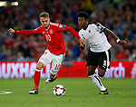 Aaron Ramsey of Wales tussles with David Alaba of Austria during the World Cup Qualifying Group D match at the Cardiff City Stadium, Cardiff. Picture date 2nd September 2017. Picture credit should read: Simon Bellis/Sportimage