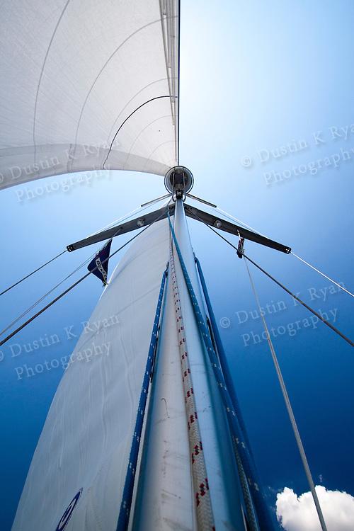 full sails while sailing a beneteau 49 sailing yacht sailboat under blue skies in charleston south carolina