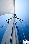 full sails while sailing a beneteau 49 sailing yacht sailboat under blue skies in charleston south carolina