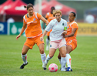 St Louis Athletica midfielder Lori Chalupny (17) controls the ball in front of Sky Blue FC  midfielder Yael Averbuch (10) and Sky Blue FC  midfielder Rosana (11) during a WPS match at Anheuser-Busch Soccer Park, in St. Louis, MO, June 7, 2009. Athletica won the match 1-0.