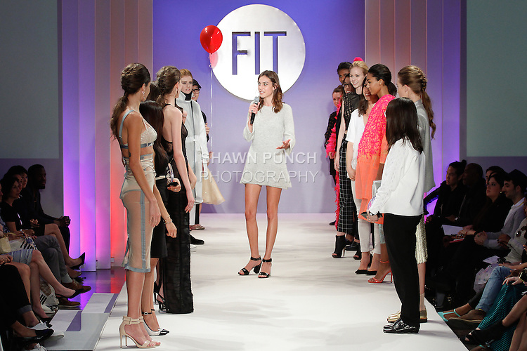 Model and hostess Alexa Chung speaks on runway, next to models and the award winning designers, at the close of the FIT Future of Fashion 2014 Graduates' Collection fashion show, at the Fashion Institute of Technology on May 1, 2014.