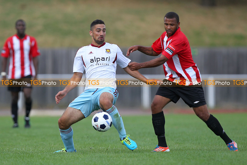 Josh Griffiths of Hornchurch tussles with Sebastien Lletget of West Ham - AFC Hornchurch vs West Ham United XI - Friendly Football Match at The Stadium, Upminster Bridge, Essex - 03/08/13 - MANDATORY CREDIT: Gavin Ellis/TGSPHOTO - Self billing applies where appropriate - 0845 094 6026 - contact@tgsphoto.co.uk - NO UNPAID USE