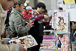 Visitors read manga books on display at the Comic Market 91 (Comiket) event in Tokyo Big Sight on December 31, 2016, Tokyo, Japan. Manga and anime fans arrived in the early morning hours on the opening day of the 3-day long event. Held twice a year in August and December, the Comiket has been promoting manga, anime, game and cosplay culture since its establishment in 1975. (Photo by Rodrigo Reyes Marin/AFLO)