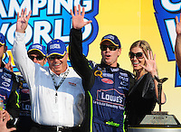 Sept. 28, 2008; Kansas City, KS, USA; Nascar Sprint Cup Series driver Jimmie Johnson (center) celebrates with wife Chandra Johnson (right) and team owner Rick Hendrick  after winning the Camping World RV 400 at Kansas Speedway. Mandatory Credit: Mark J. Rebilas-