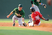 Tzu-Wei Lin (36) of the Greenville Drive is out at second as  second baseman Jonathan Johnson (5) of the Savannah Sand Gnats takes the throw on Friday, August 22, 2014, at Fluor Field at the West End in Greenville, South Carolina. (Tom Priddy/Four Seam Images)