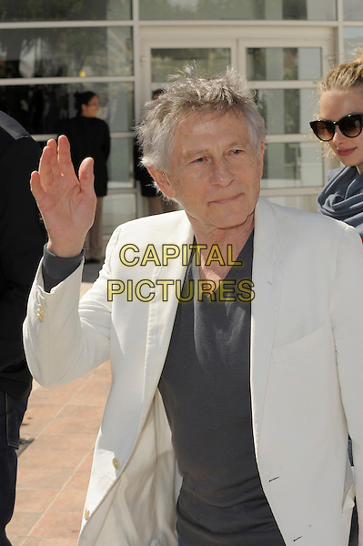 Roman Polanski.'La Venus A La Fourrure'  photocall at the 66th Cannes Film Festival, France 23rd May 2013.half length grey gray top white suit jacket hand arm waving palm.CAP/PL.©Phil Loftus/Capital Pictures.