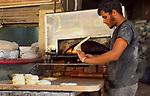 An Egyptian vendor prepares breads on the Muslim holy fasting month of Ramadan at market in Cairo, Egypt, on June 10, 2017. Ramadan is sacred to Muslims because it is during that month that tradition says the Koran was revealed to the Prophet Mohammed. The fast is one of the five main religious obligations under Islam. More than 1.5 billion Muslims around the world will mark the month, during which believers abstain from eating, drinking, smoking and having sex from dawn until sunset. Photo by Amr Sayed
