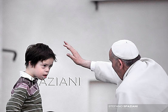 Pope Francis blesses a child  the Pentecost vigil on St Peter's square at the Vatican. May 18, 2013
