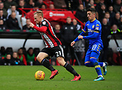 10th February 2018, Bramall Lane, Sheffield, England; EFL Championship football, Sheffield United versus Leeds United; Mark Duffy of Sheffield United is tracked by Pablo Hernandez of Leeds United