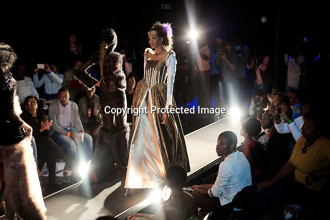 SOWETO, SOUTH AFRICA MAY 29: Models for the designer Inventive Fashion by Zamaswazi walk with garments during a fashion show at Soweto Fashion Week on May 29, 2014 at the Soweto Theatre in the Jabulani section of Soweto, South Africa. Local emerging designers showed their collections during the three-day event held at the theatre. Founded in 2012, Soweto fashion week gives a platform to local designers, models and artists. (Photo by: Per-Anders Pettersson)