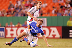 Aug 19 2007:  Davy Arnaud (22) of the Wizards is knocked off the ball by Adam Cristman (7) of the Revolution.  The MLS Kansas City Wizards were defeated by the visiting New England Revolution 0-1 at Arrowhead Stadium in Kansas City, Missouri, in a regular season league soccer match.