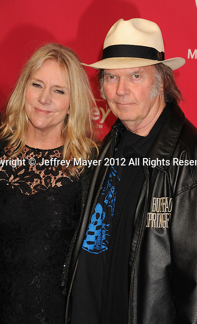 LOS ANGELES, CA - FEBRUARY 10: Neil Young and Pegi Young arrive at The 2012 MusiCares Person of The Year Gala Honoring Paul McCartney at the Los Angeles Convention Center on February 10, 2012 in Los Angeles, California.