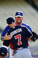 Peter Moylan #41 of the Los Angeles Dodgers greets former teammate Reed Johnson #7 of the Atlanta Braves before a game at Dodger Stadium on June 6, 2013 in Los Angeles, California. (Larry Goren/Four Seam Images)