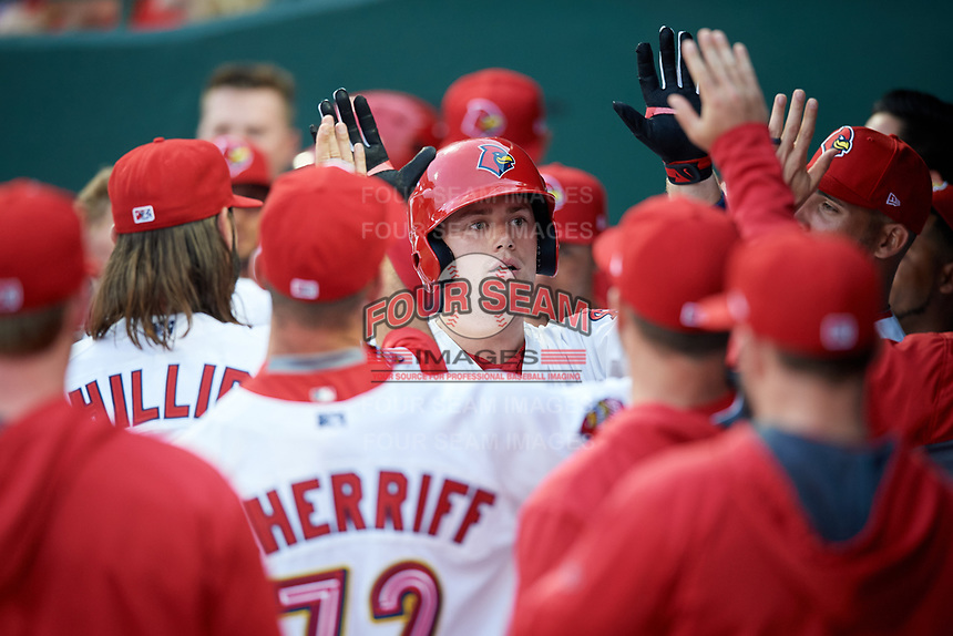 Memphis Redbirds catcher Carson Kelly (19) high fives with his teammates in the dugout after hitting a home run in the bottom of the fourth inning during a game against the Round Rock Express on April 28, 2017 at AutoZone Park in Memphis, Tennessee.  Memphis defeated Round Rock 9-1.  (Mike Janes/Four Seam Images)