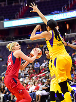 Washington, DC - June 15, 2018: Washington Mystics guard Elena Delle Donne (11) makes a move to the basket against Los Angeles Sparks forward Candace Parker (3) during game between the Washington Mystics and Los Angeles Sparks at the Capital One Arena in Washington, DC. (Photo by Phil Peters/Media Images International)