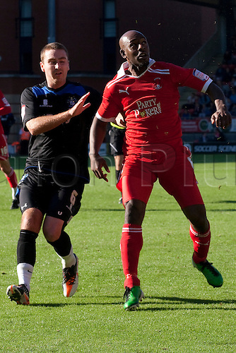 15.10.2011, London, England. Peter Sweeney Bury's midfielder and Kevin Lisbie Orient's striker in action during the NPower league one football match between Leyton Orient and Bury played at the Matchroom Stadium, Brisbane Road, London. Mandatory credit: ActionPlus