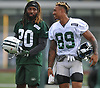 Marcus Williams #20, left, jokes with Jalin Marshall #89 during New York Jets Training Camp at the Atlantic Health Jets Training Center in Florham Park, NJ on Thursday, Aug. 10, 2017.