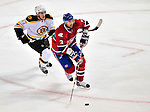 24 September 2009: Montreal Canadiens' defenseman Ryan O'Byrne (3) is persued by left wing forward Jeff LoVecchio during a game against the Boston Bruins at the Bell Centre in Montreal, Quebec, Canada. The Bruins edged out the Canadiens 2-1 in an overtime shootout of their pre-season matchup. Mandatory Credit: Ed Wolfstein Photo