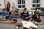 Young hippies in the town square. The Hay Festival, Hay on Wye, Powys, Wales, Great Britain. 2006.