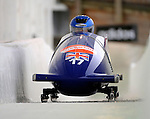 15 December 2007: Great Britain 1 pilot Nicola Minichiello, with Nicola Minichiello on the brakes, head down the straightaway towards Turn 16 during their second run of the FIBT World Cup Bobsled Competition at the Olympic Sports Complex on Mount Van Hoevenberg, at Lake Placid, New York, USA. ..Mandatory Photo Credit: Ed Wolfstein Photo