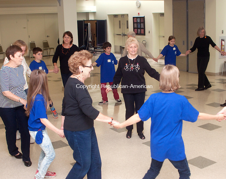SOUTHBURY- OCTOBER 29 2014 102914DA03- Line dance instructor Sherry Milck, center, gives a class to seniors and 5th-grade students of Pomperaug Elementary School in Southbury during a session of Pals &quot;Bridging the Gap&quot; . Once a month Pals will be visiting the Southbury Senior Center and spend time with the members for an hour. The town will hire a part-time worker to staff the building at night due to an increase in the number of programs being held at the center.<br /> Darlene Douty Republican American