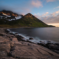 Summer midnight sun light over coast and mountain peaks, Mefjordvær, Senja, Norway