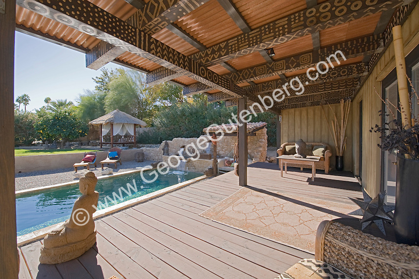 Stock photo of residential swimming pool and patio stock for Rustic covered decks