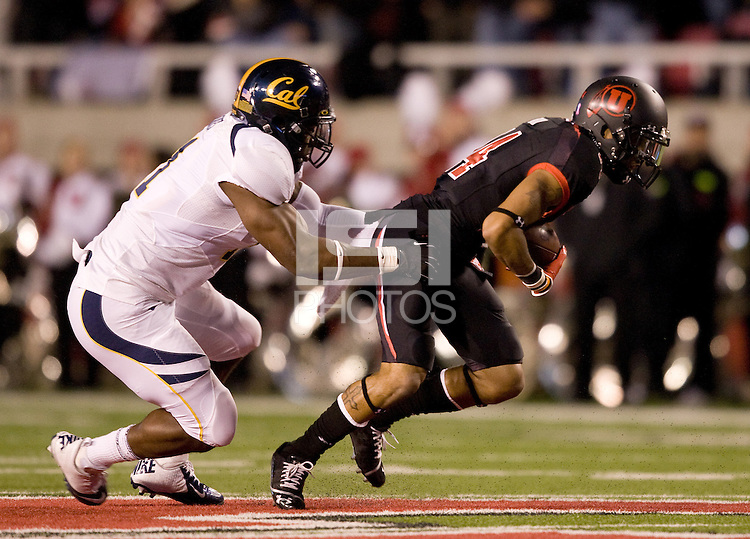 Nick Forbes of California tries to tackle Reggie Dunn of Utah during the game at Rice-Eccles Stadium in Salt Lake City, Utah on October 27th, 2012.   Utah Utes defeated California, 49-27.