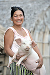 Korb Thouen cares for her pig in Thnort Rorleung, a village in the Kampot region of Cambodia.