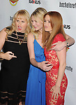 HOLLYWOOD, CA - AUGUST 23: Rebel Wilson, Kirsten Dunst and Isla Fisher arrive at the Los Angeles premiere of 'Bachelorette' at the Arclight Hollywood on August 23, 2012 in Hollywood, California.