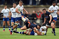 Sean Kennedy of Edinburgh Rugby is tackled to ground by Dave Attwood of Bath Rugby. Pre-season friendly match, between Edinburgh Rugby and Bath Rugby on August 17, 2018 at Meggetland Sports Complex in Edinburgh, Scotland. Photo by: Patrick Khachfe / Onside Images