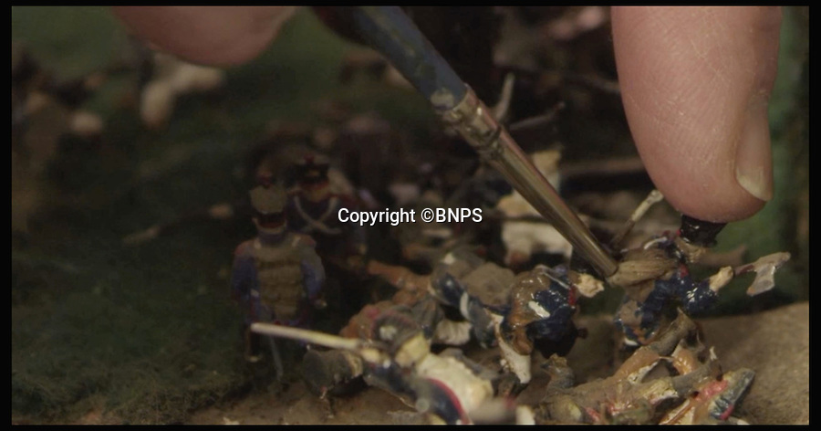 BNPS.co.uk (01202 558833)<br /> Pic: PhilYeomans/BNPS<br /> <br /> Stills from the video<br /> <br /> Historic battle brought back to life...<br /> <br /> A stunning diorama of the battle of Waterloo has been restored to its former glory after a painstaking cleaning operation to remove nearly 50 years of dust.<br /> <br /> The sweeping panorama contain's 21,500 figures and nearly 10,000 horses, each of which has been meticulously cleaned by hand over the last five months by husband and wife team Kelvin and Mary Thatcher from Norfolk.<br /> <br /> The pristine model has now gone back on display at the refurbished Royal Green jackets museum in Winchester.<br /> <br /> A sobering fact is that there were over twice as many casualties in the actual battle as there are figures on the diorama.