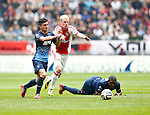 Nederland, Amsterdam, 30 maart 2014<br /> Eredivisie<br /> Seizoen 2013-2014<br /> Ajax-FC Twente<br /> Felipe Gutierrez (l.) van FC Twente en Davy Klaassen (2e van r.) van Ajax strijden om de bal.