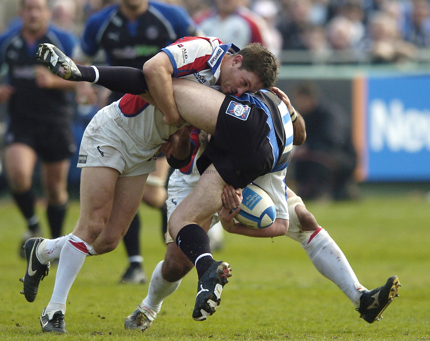 Photo: Jonathan Butler..Bath Rugby v Bristol Rugby. European Challenge Cup. 31/03/2007..Sam Cox (L) of Bristol sends Tom Cheeseman (B) of Bath into the air with a crunching tackle.