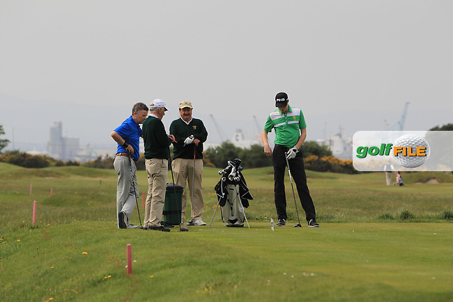 Robin Dawson (Waterford) and his team on the 3rd tee during the Flogas Irish Amateur Open Championship Am-Am at Royal Dublin on Monday 9th May 2016.<br /> Picture:  Thos Caffrey / www.golffile.ie